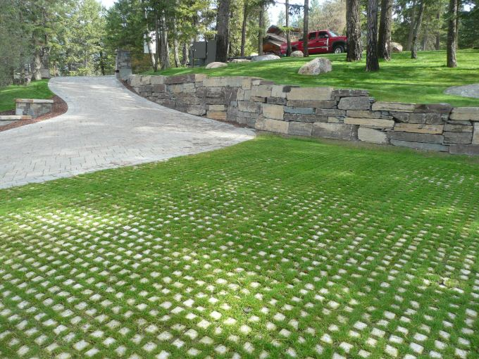 Similar to prior image, this is a photograph of the pavers used as a parking lot in a place resembling a park or posh neighborhood.